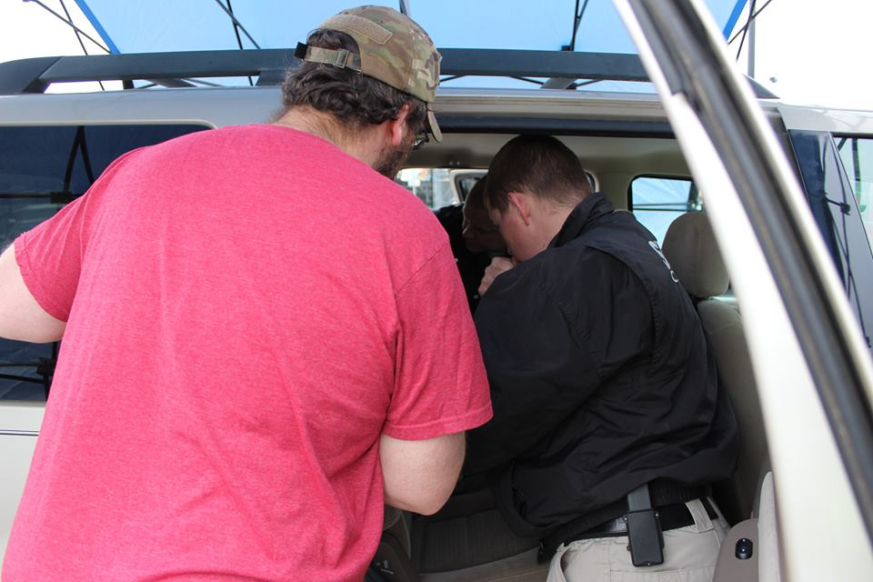 Deputy Performing Child Safety Seat Inspection