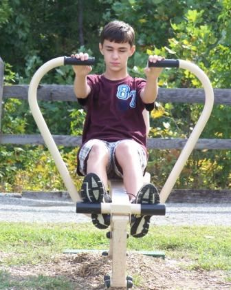 Boy Using Fitness Equipment
